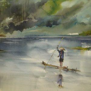 homme en pleine pêche sur l'eau