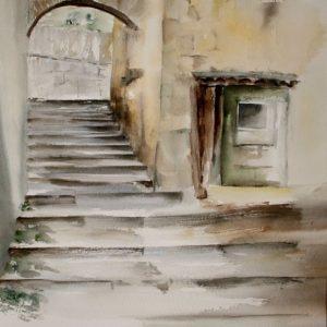 en bas des escalier d'une ruelle